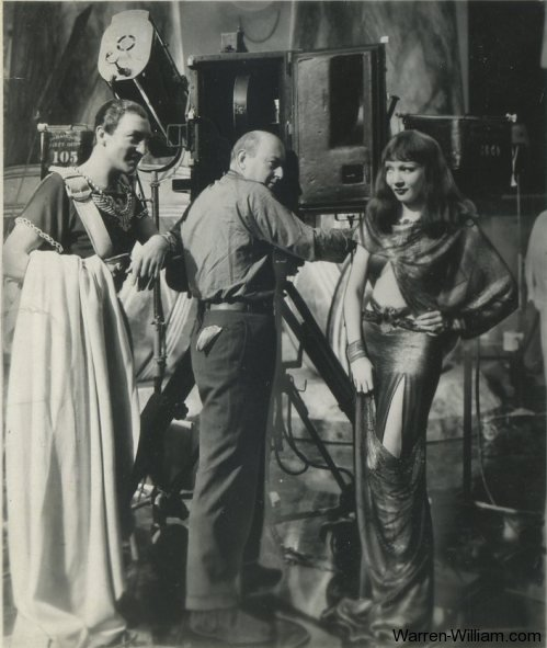 Warren William and Claudette Colbert on the set of Cleopatra