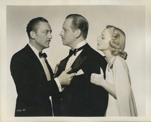 Warren William, Melvyn Douglas, and Virginia Bruce in Arsene Lupin Returns (1938)