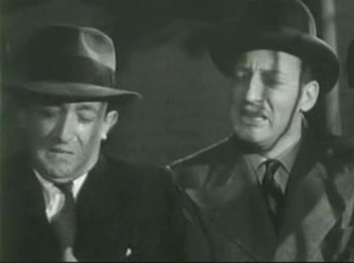 Allen Jenkins and Warren William in The Case of the Curious Bride