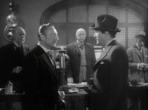Warren William and George Sanders in The Private Affairs of Bel Ami