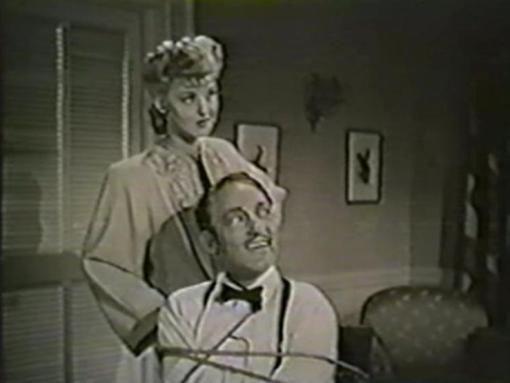 Warren William and Ann Savage