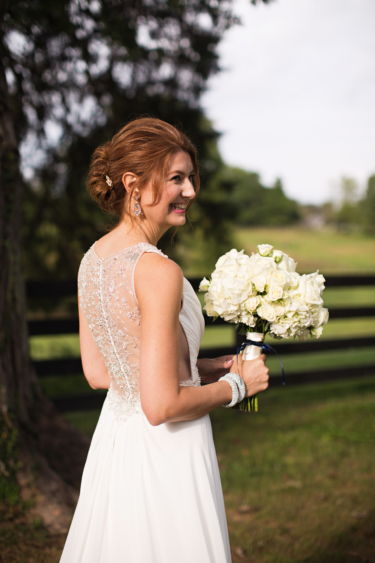 Kentucky summer estate wedding- Bride simple jewelry and all white bridal bouquet