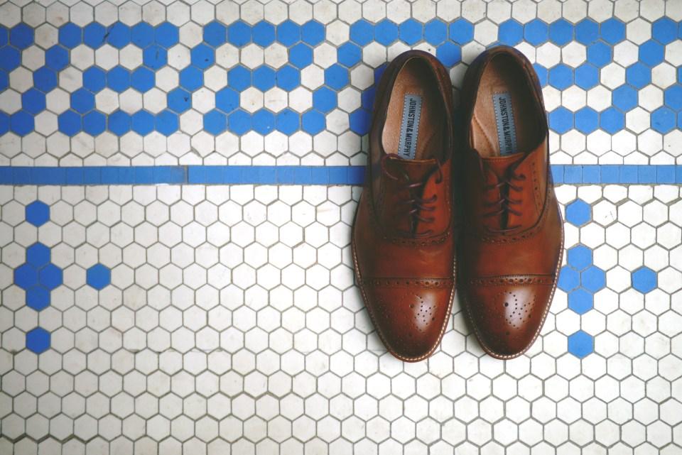 Groom's shoes on bathroom tile