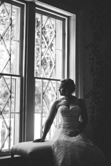 Black and white image of bride in Warrenwood Manor Bridal Suite