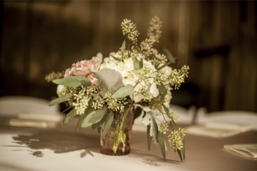 Small floral centerpieces with ecalyptus