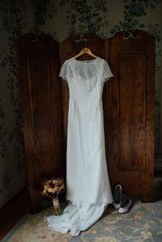 Capsleeve bridal gown with Bridal Bouqet and Silver Flats