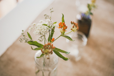 Bud vases on burlap runner