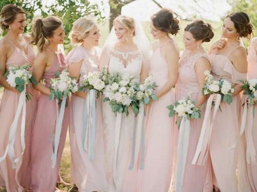 Bridal Party in flowy blush dresses with garden bouquets