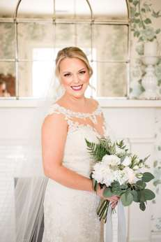 Bride in sweetheart cut wedding dress with illusion neck