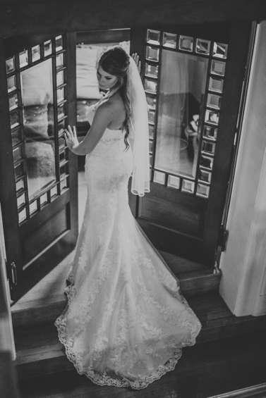 Country Rustic Bride in mermaid dress train in historic Warrenwood Manor, a Kentucky wedding venue.
