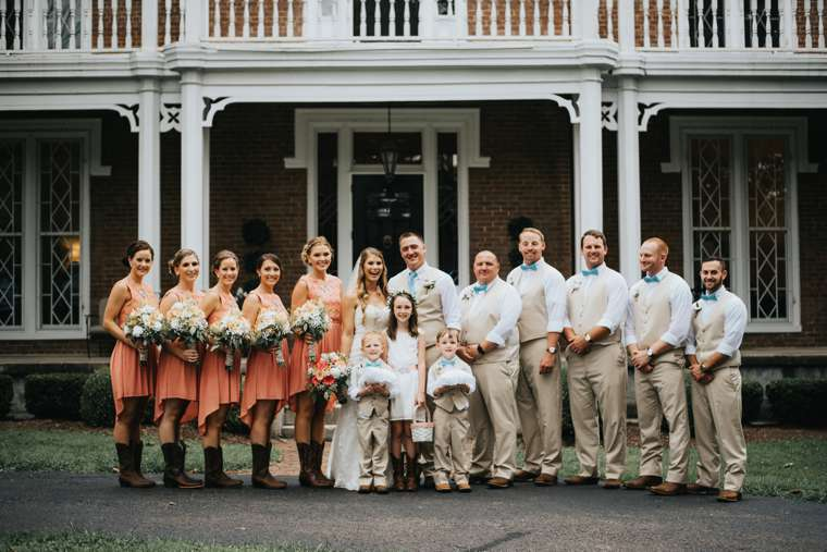 Rustic country wedding party in coral, khaki and blue