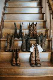 Bridesmaids boots for a rustic country wedding at Warrenwood Manor, a central Kentucky wedding venue.