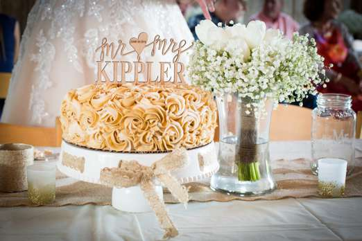 Rosette textured single-tier wedding cake with wood laser cut cake topper