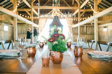Vineyard table and chairs with copper accents in Warrenwood Manor Barn