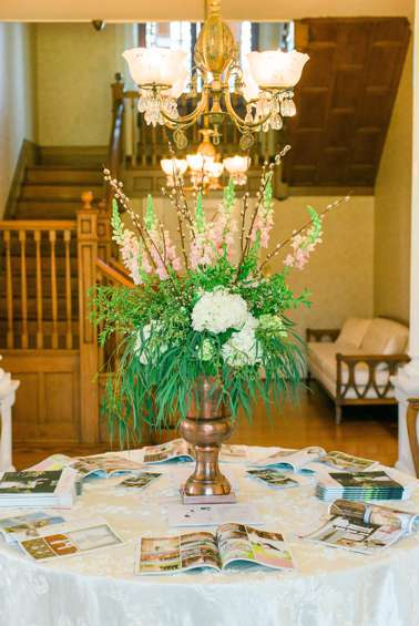 Entry Hall at Warrenwood Manor with large floral arrangement