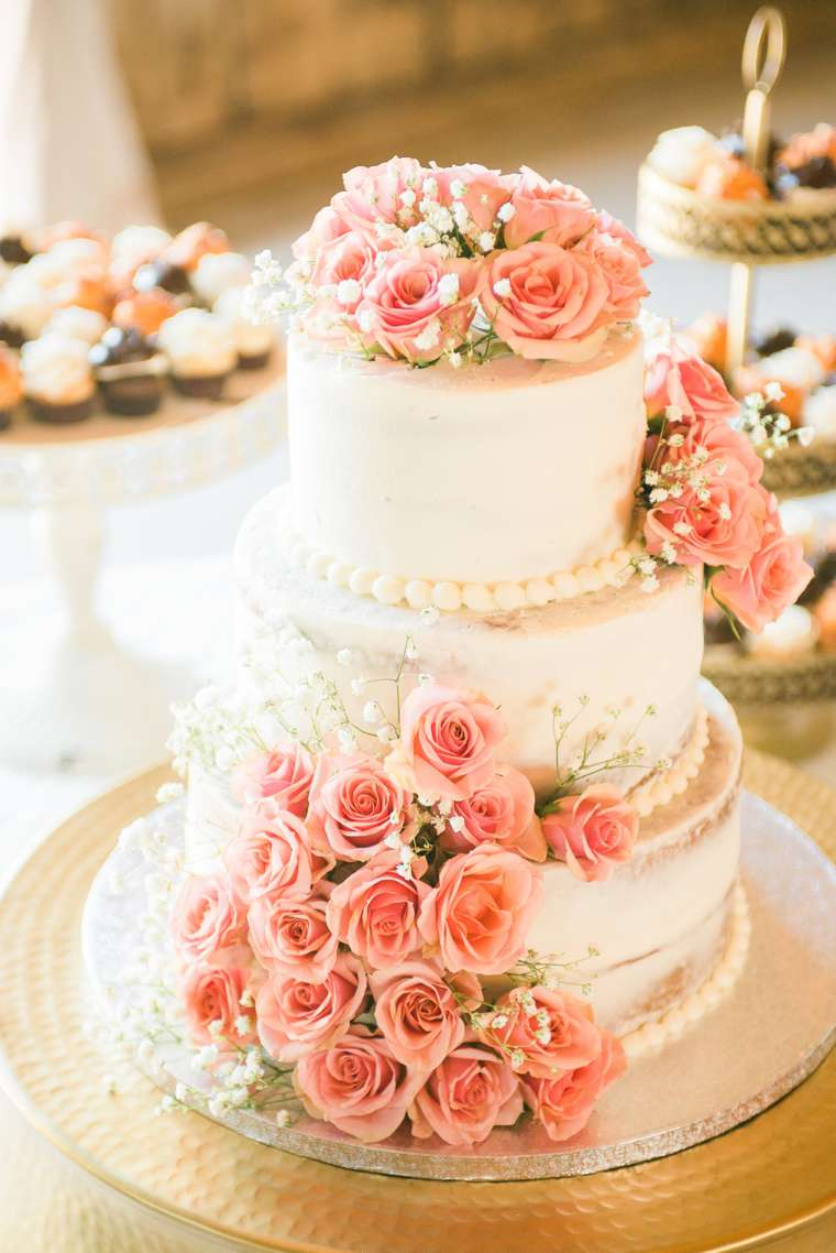 Three-tier ivory naked cake with pink roses by Sweets by Cindy