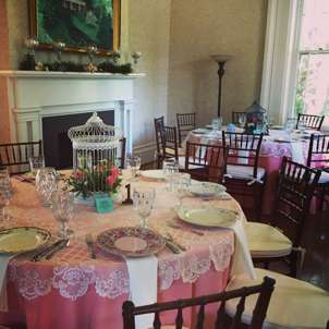 Pink and teal reception tablescape in Warrenwood Manor
