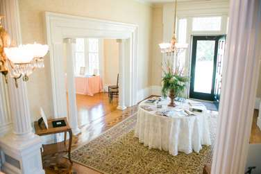 Entry hall of historic home with greek revival details