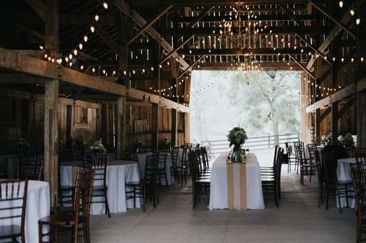 Rustic barn reception with burlap runners