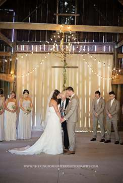Wedding ceremony in barn with champagne color palette