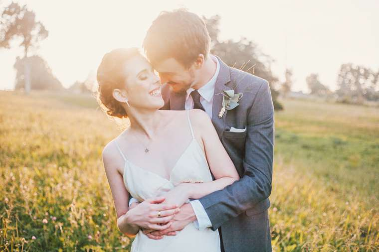 Couple at sunset in field during their Kentucky estate wedding