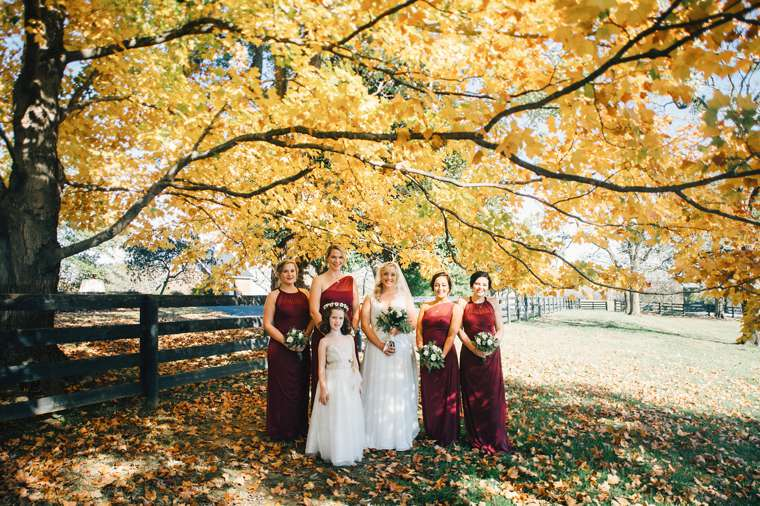 Bridal party in marsala with fall leave