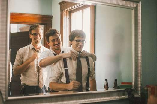Groom and groomsmen get ready in Warrenwood Groom's Quarters