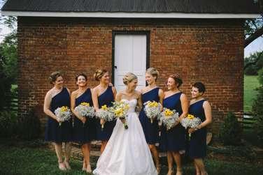 Bridesmaids dressed in Navy one-shoulder dresses at summer Warrenwood wedding
