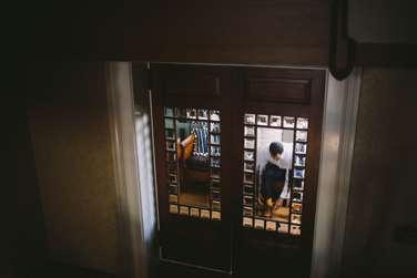 Craftsmen style glass doors in grooms quarters of wedding venue