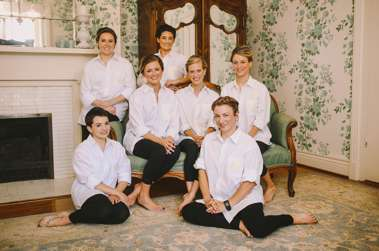 Bridal Party getting ready in black tights and monogrammed button-down