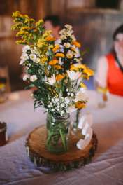 Yellow and white rustic centerpiece