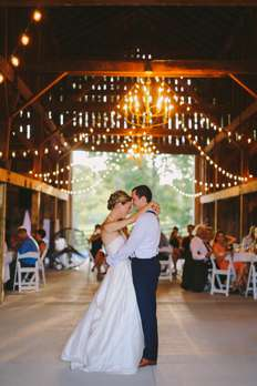 Wedding barn with chandeliers and string lights