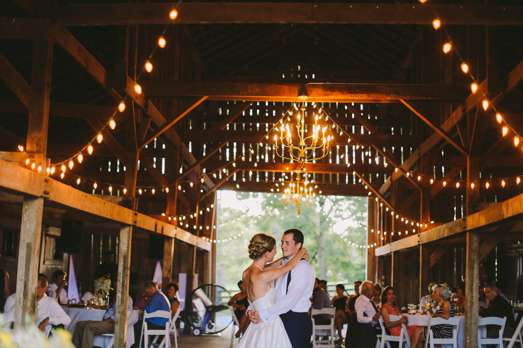 Kentucky Wedding barn with chandeliers and string lights