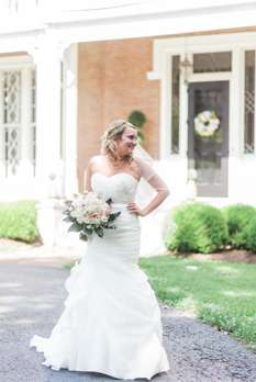 Bride in front of Kentucky historic gothic revival home
