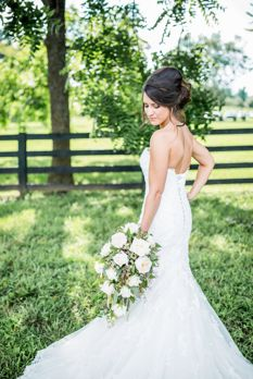 Bride with cascading bouquet and long train dress