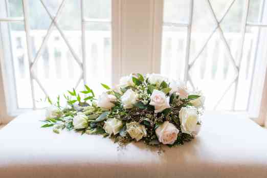 Cascade bridal bouquet with white roses by Ellis Florist, Photo by Becky Willard Photography