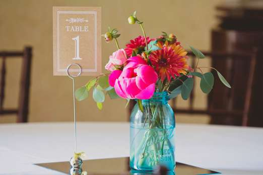 Vibrant centerpiece with pink & orange flowers in ball mason jar. Fields in Bloom. Josephine May Photography.