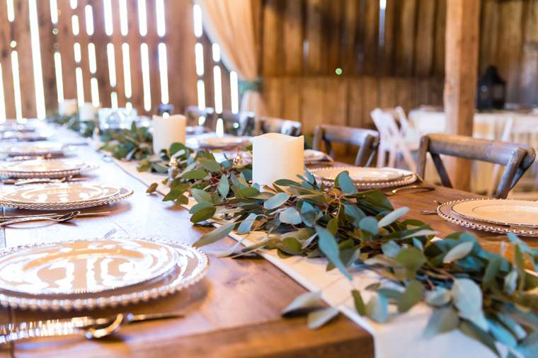 Eucalyptuc garland on runner down banquet table. Meghan Thomas Photography.