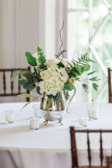 Traditional centerpiece, white & green, in silver pitcher. Emily Wakin Photography