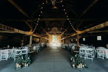 Romantic barn setting for wedding ceremony and reception