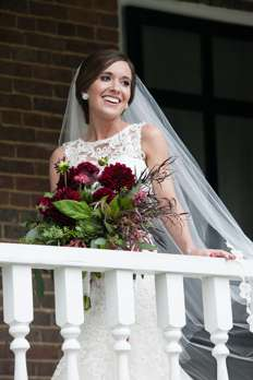 Bride with Burgundy bridal bouquet for classy glam fall wedding