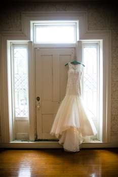 Wedding dress hanging in old house turned wedding venue in Kentucky
