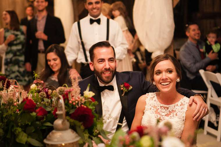 Bride & groom enjoy their rustic glam wedding reception