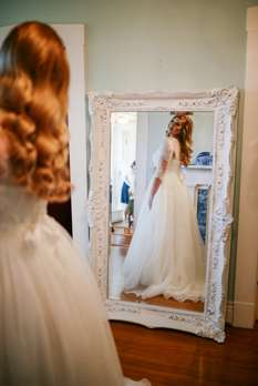 Bride getting ready in Warrenwood Bridal suite
