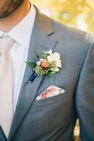 Groomsmen Attire for fall wedding | Gray suit, pale pink tie, floral pocket square & boutonniere
