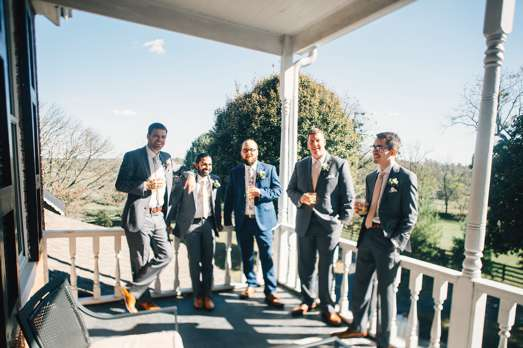 Candid photo of groomsmen at Kentucky fall farm wedding