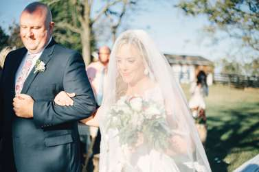 Bride and Father of the Bride enter outdoor fall ceremony