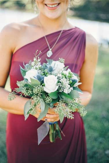 White and blue bridesmaid bouquet with marsala/burgundy bridesmaid dress