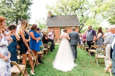 Bride and FOB enter outdoor ceremony during KY summer wedding