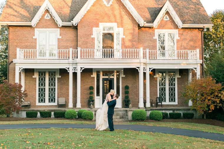 Bride & Groom celebrate in front of historic Kentucky mansion, wedding venue with southern charm